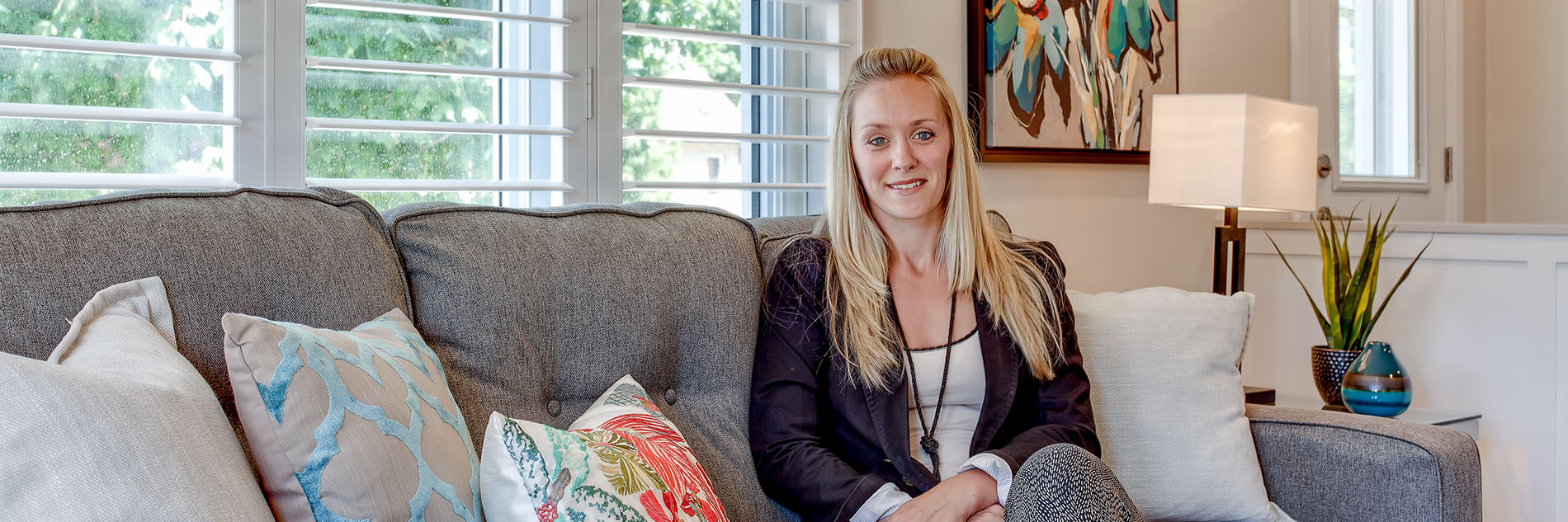 woman on couch centre staged home