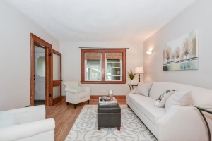Home staging showcasing fully staged Century home living room