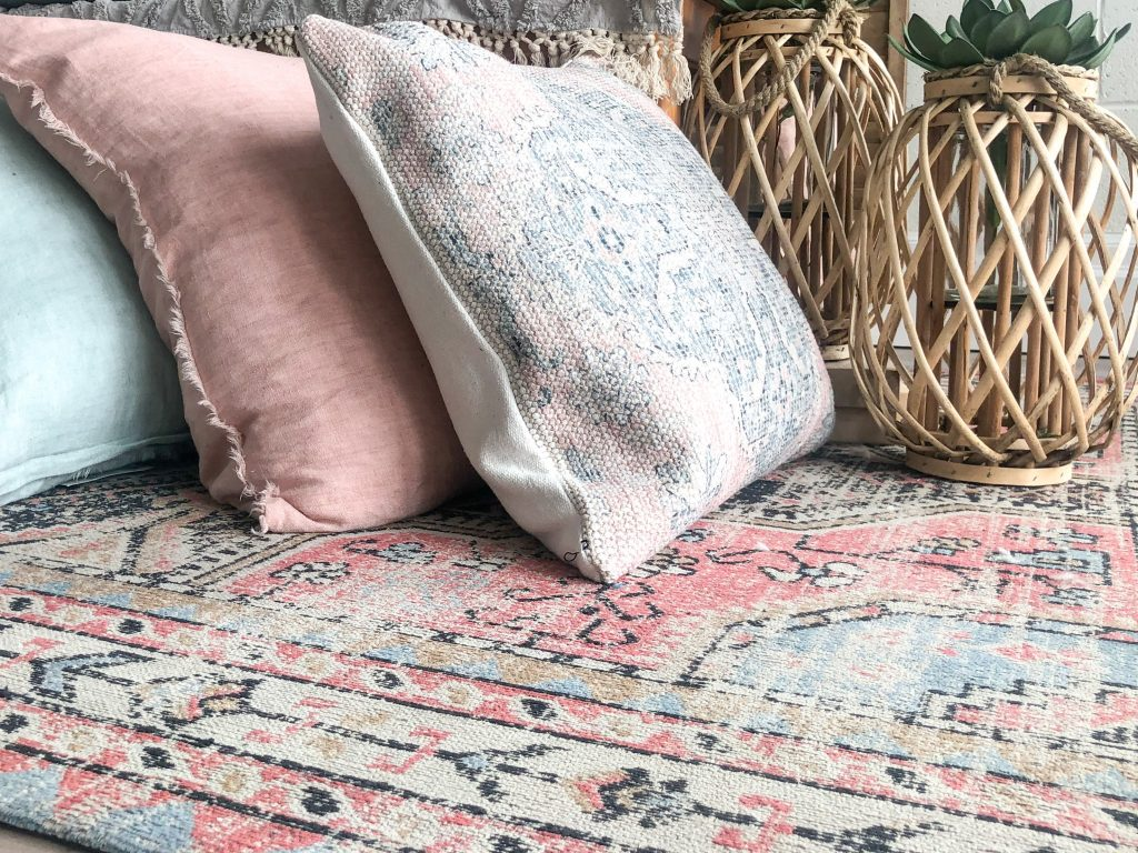 Persian or boho rug with a pink, green, beige pattern