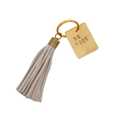 Motivational leather tassel key chain that reminds us to be nice