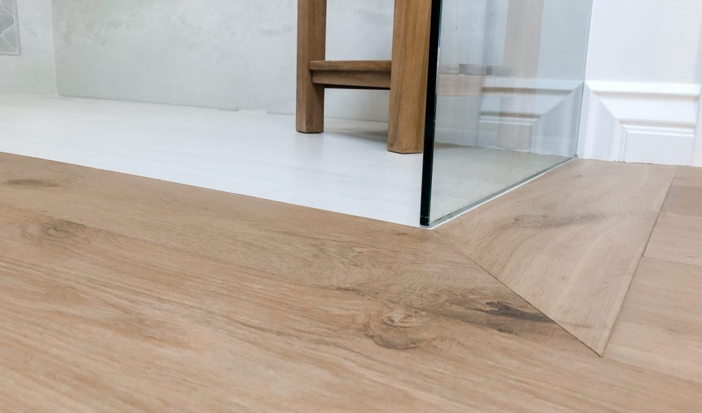 Hardwood Floor transition into shower